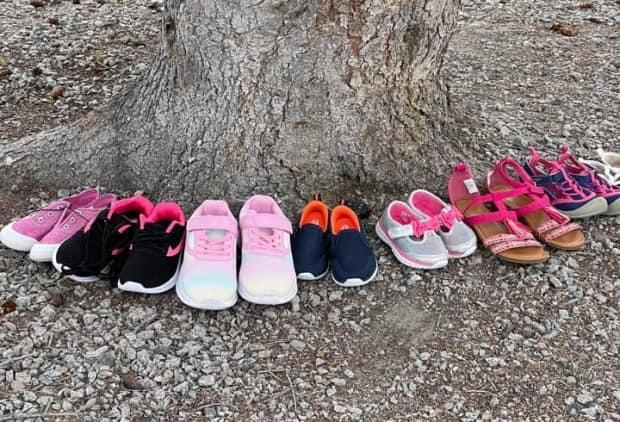 An event page on Facebook is calling on people to bring donations of childrens' shoes to the tree at the site of the former old Akaitcho Hall residential school in Yellowknife, N.W.T.