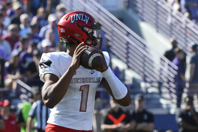 UNLV quarterback Armani Rogers (1) looks pass during the first half of an NCAA college football game against Northwestern, Saturday, Sept. 14, 2019, in Evanston, Ill. (AP Photo/Matt Marton)