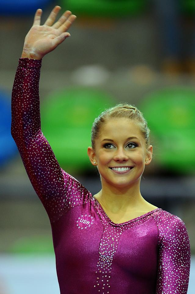 GUADALAJARA, MEXICO - OCTOBER 27:  Shawn Johnson of the United States celebrates after the Women's Artistic Gymnastics Finals in Uneven Bars during Day 13 of the XVI Pan American Games at the Revolution Sports Complex on October 27, 2011 in Guadalajara, Mexico.  (Photo by Dennis Grombkowski/Getty Images)