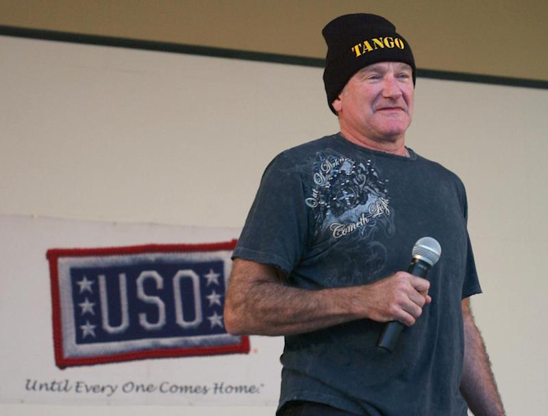 In this December 17, 2007 US Army handout photo, US actor and comedian Robin Williams performs for US troops at Camp Arifjan, Kuwait, during a brief United Service Organization holiday troop visit