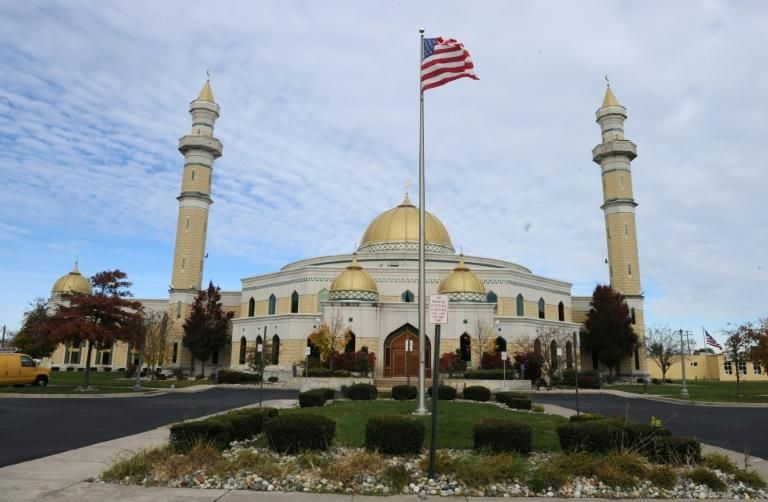 A US national flag is seen in front of the Islamic Center of America in Dearborn, Michigan on November 9, 2016 This Detroit suburb is home to one of the biggest populations of Muslims and Arabs in the United States, and Musid was among many in her community trying to make sense of the brash Republican's election. Across the country, Muslim Americans are now wondering what a Trump presidency might mean, said Hazem Bata, head of the Islamic Society of North America, a national advocacy group