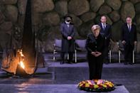 German Chancellor Angela Merkel pauses after laying a wreath in the Hall of Remembrance at the Yad Vashem Holocaust Museum in Jerusalem as Israeli Prime Minister Naftali Bennett looks on (AFP/Gil COHEN-MAGEN)