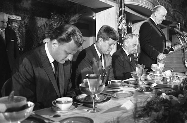 "<p>President John F. Kennedy and others at the head table bow their heads during the invocation at the annual ""Presidential prayer breakfast"" in a Washington hotel, Feb. 9, 1961. From left: Billy Graham, Kennedy; Sen. Frank Carlson, R-Kan., and Judge Boyd Leedom of Washington, president of the International Christian Leadership Conference, the sponsoring organization. (Photo: Henry Burroughs/AP) </p>"