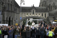 Pope Francis waves to the waiting crowds on Christchurch, Dublin as he travels in the Popemobile during his visit to Ireland, Saturday, Aug. 25, 2018. (Brian Lawless/PA via AP)