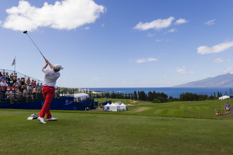 Webb Simpson drives on the first tee during the third round of the Tournament of Champions golf tournament, Sunday, Jan. 5, 2014, in Kapalua, Hawaii. (AP Photo/Marco Garcia)