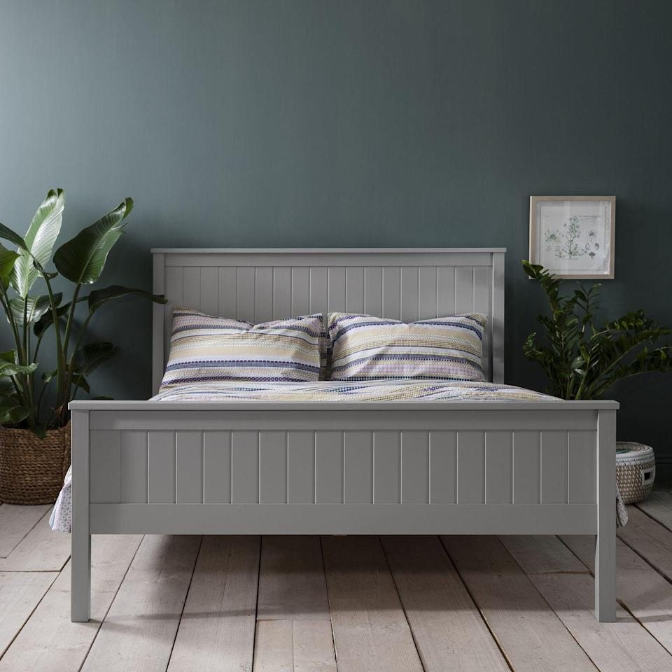 """<p>Grey and green is a great combination to bring the colours of nature into the home. The chalky matte green walls contrasts perfectly with this soft grey bed frame. To elevate this grey bedroom idea, add a striking tall houseplant, which will also help to create a calm environment.</p><p>Pictured: <a href=""""https://go.redirectingat.com?id=127X1599956&url=https%3A%2F%2Fwww.noaandnani.co.uk%2Fdouble-beds-c30%2Fdorchester-kingsize-pine-bed-in-silk-grey-p947&sref=https%3A%2F%2Fwww.housebeautiful.com%2Fuk%2Fdecorate%2Fbedroom%2Fg35432015%2Fgrey-bedroom-ideas%2F"""" rel=""""nofollow noopener"""" target=""""_blank"""" data-ylk=""""slk:Dorchester king size bed in Silk Grey, Noa and Nani"""" class=""""link rapid-noclick-resp"""">Dorchester king size bed in Silk Grey, Noa and Nani </a></p>"""