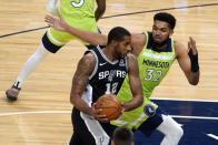 Minnesota Timberwolves' Karl-Anthony Towns, right, chases San Antonio Spurs' LaMarcus Aldridge who drives in the first half of an NBA basketball game Saturday, Jan. 9, 2021, in Minneapolis. (AP Photo/Jim Mone)