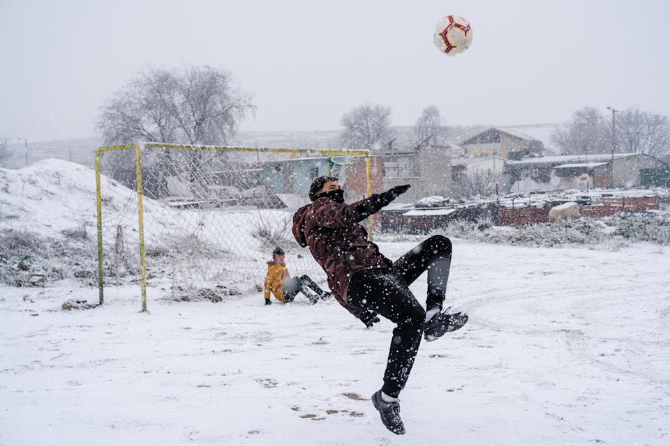 A young man playing soccer in the La Ca�ada Real neighbourhood during heavy snowfall. Spain registers historical low temperatures and snowfalls putting the community of Madrid on alert. In the south of Madrid, La Ca�ada Real, the community has been deprived of electricity for 3 months. (Photo by Diego Radames / SOPA Images/Sipa USA)
