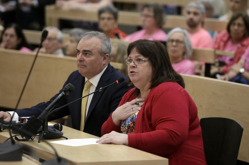 """Mass. state Rep. Colleen Garry, D-Dracut, right, testifies against a proposed bill, called the """"Roe Act"""" by supporters, as Mass. state Rep. David DeCoste, R-Plymouth, left, looks on during a public hearing at the Statehouse, Monday, June 17, 2019, in Boston. Proponents on both sides of the abortion issue testified during the public hearing on a bill that would let women obtain an abortion after 24 weeks of pregnancy in cases of """"fatal fetal anomalies."""" (AP Photo/Steven Senne)"""