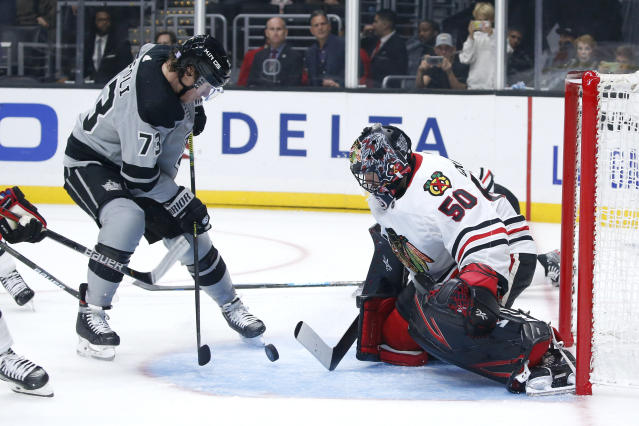 Chicago Blackhawks goalie Corey Crawford (50) makes a save on a shot by Los Angeles Kings forward Tyler Toffoli (73) during the overtime of an NHL hockey game Saturday, Nov. 2, 2019, in Los Angeles. The Kings won 4-3. (AP Photo/Ringo H.W. Chiu)