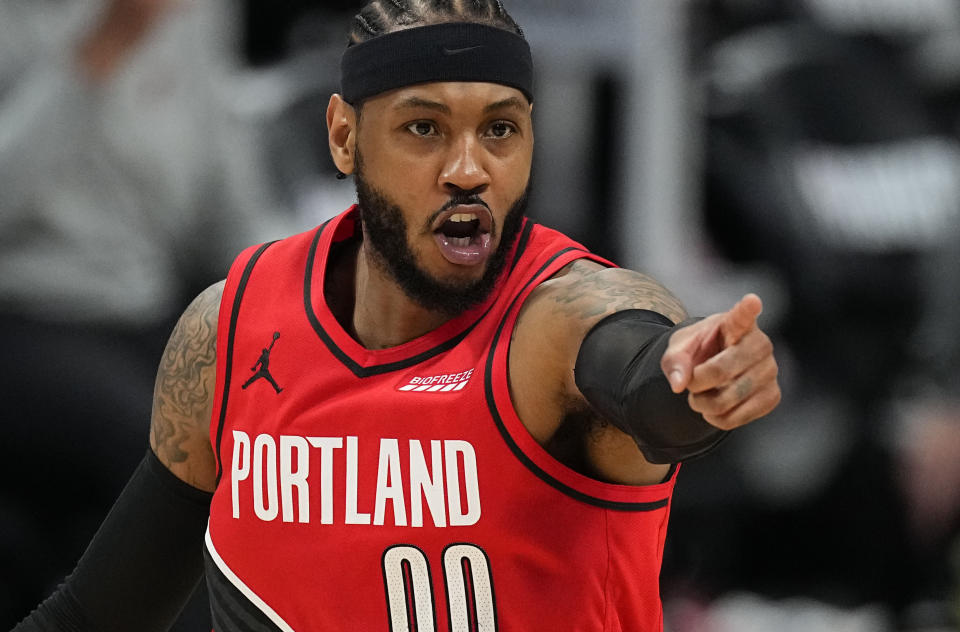 FILE - In this May 22, 2021, file photo, Portland Trail Blazers forward Carmelo Anthony (00) points to a teammate after a basket against the Denver Nuggets in the second half of Game 1 of a first-round NBA basketball playoff series in Denver. Anthony agreed to a one-year deal to join the Los Angeles Lakers on Tuesday, Aug. 3, 2021. (AP Photo/Jack Dempsey, File)