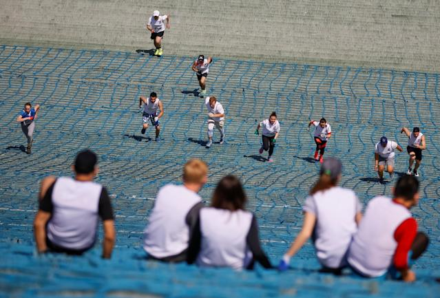 Athletes compete in relay at the Red Bull 400 uphill sprint at the Sunkar International Ski Jumping Complex in Almaty, Kazakhstan May 20, 2018. REUTERS/Shamil Zhumatov