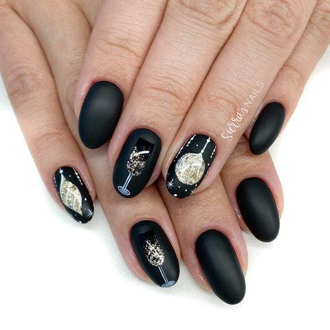 """<p>These black-and-sparkly nails can also <a href=""""https://www.goodhousekeeping.com/beauty/nails/tips/g194/christmas-nail-art/"""" rel=""""nofollow noopener"""" target=""""_blank"""" data-ylk=""""slk:pass for a Christmas design"""" class=""""link rapid-noclick-resp"""">pass for a Christmas design</a>, if you want to make the most out of your manicure. </p><p><a href=""""https://www.instagram.com/p/B6ve-N3F3tU/&hidecaption=true"""" rel=""""nofollow noopener"""" target=""""_blank"""" data-ylk=""""slk:See the original post on Instagram"""" class=""""link rapid-noclick-resp"""">See the original post on Instagram</a></p>"""