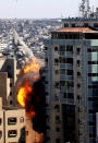 A view of a 11-story building housing AP office and other media in Gaza City is seen as Israeli warplanes demolished it, Saturday, May 15, 2021. The airstrike Saturday came roughly an hour after the Israeli military ordered people to evacuate the building. There was no immediate explanation for why the building was targeted. The building housed The Associated Press, Al-Jazeera and a number of offices and apartments. (AP Photo/Hatem Moussa)