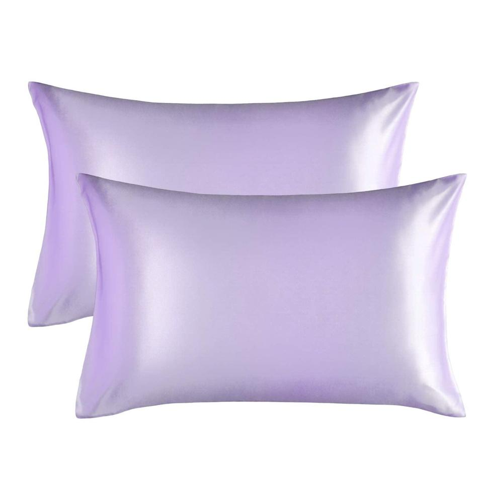 """<h2>Bedsure Satin Pillowcase</h2><br>""""They make my bed look sensual!"""" one Amazon reviewer raves of <a href=""""https://www.refinery29.com/en-us/2021/03/10395279/amazon-bedsure-satin-pillowcase"""" rel=""""nofollow noopener"""" target=""""_blank"""" data-ylk=""""slk:the $10 satin pillowcase"""" class=""""link rapid-noclick-resp"""">the $10 satin pillowcase</a> that's quickly risen to viral-bestseller status. Beauty industry pros tout the benefits of sleeping with a satin or silk pillowcase for fewer breakouts and smoother hair to skin — """"I ordered these to help protect against hair breakage and have already noticed a huge difference,"""" another rave reviewer cooed. <br><br><em>Shop <strong><a href=""""https://amzn.to/3foPyAy"""" rel=""""nofollow noopener"""" target=""""_blank"""" data-ylk=""""slk:Amazon"""" class=""""link rapid-noclick-resp"""">Amazon</a></strong></em><br><br><strong>Bedsure</strong> Satin Pillowcase for Hair and Skin, 2-Pack, Lavender, $, available at <a href=""""https://amzn.to/3sAR6Ln"""" rel=""""nofollow noopener"""" target=""""_blank"""" data-ylk=""""slk:Amazon"""" class=""""link rapid-noclick-resp"""">Amazon</a>"""