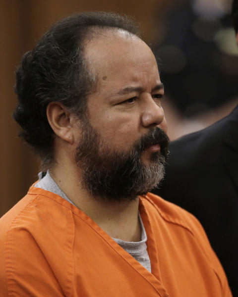 FILE - This Wednesday, July 17, 2013 file photo shows Ariel Castro standing before a judge during his arraignment on an expanded 977-count indictment in Cleveland. Castro, who held 3 women captive for a decade, has committed suicide, Tuesday, Sept. 3, 2013. (AP Photo/Tony Dejak, file)