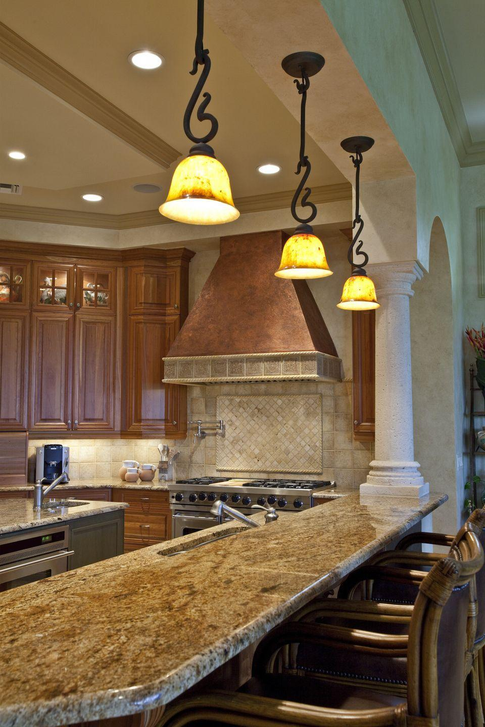 <p>This style was <em>everywhere </em>in the early 2000s, and we can certainly see its appeal. Today's kitchens, however, focus on creating a light, airy place to cook, rather than emulating a dark Italian villa. </p>