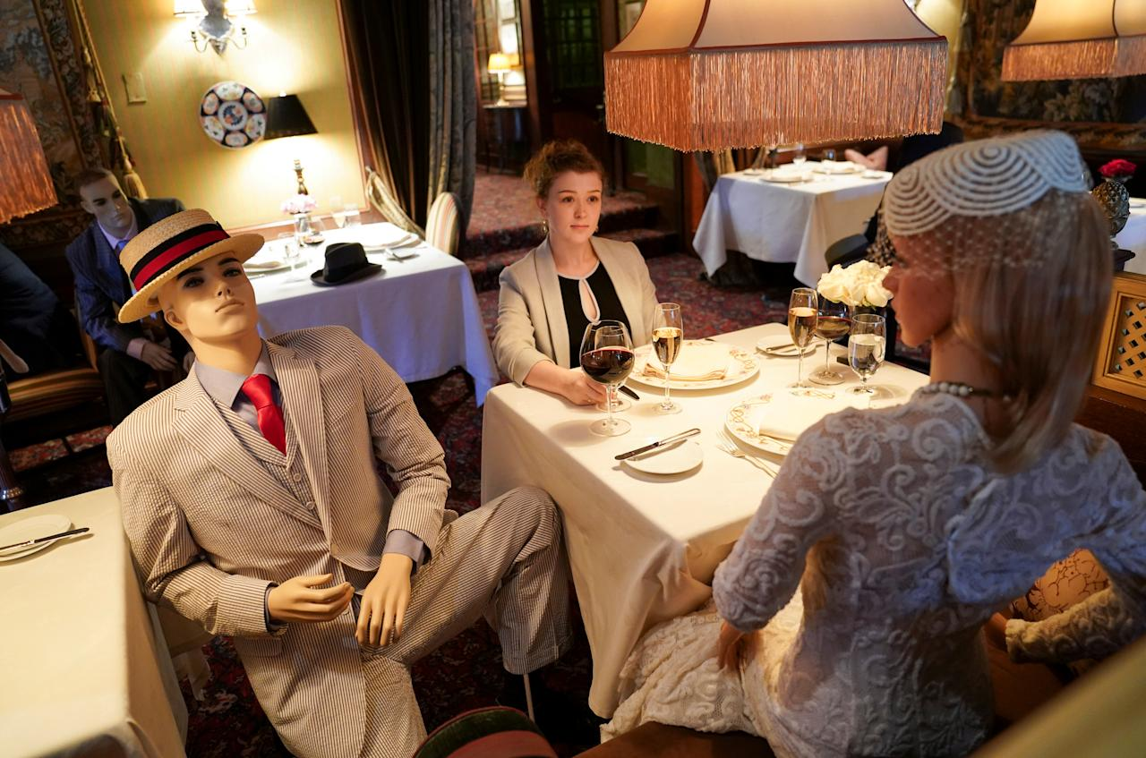 Executive Assistant Jessie Dawson sits among mannequins occupying some tables so diners will not feel isolated by coronavirus disease (COVID-19) social distancing measures when The Inn at Little Washington, a Michelin three-star restaurant, reopens shortly in Washington, Virginia, U.S., May 20, 2020. REUTERS/Kevin Lamarque     TPX IMAGES OF THE DAY