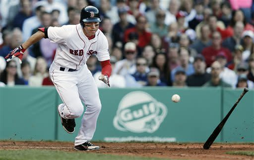 Boston Red Sox's Jacoby Ellsbury runs out a hit near the plate that was ruled foul during the fifth inning of a baseball game against the Oakland Athletics at Fenway Park in Boston, Wednesday, April 24, 2013. (AP Photo/Winslow Townson)