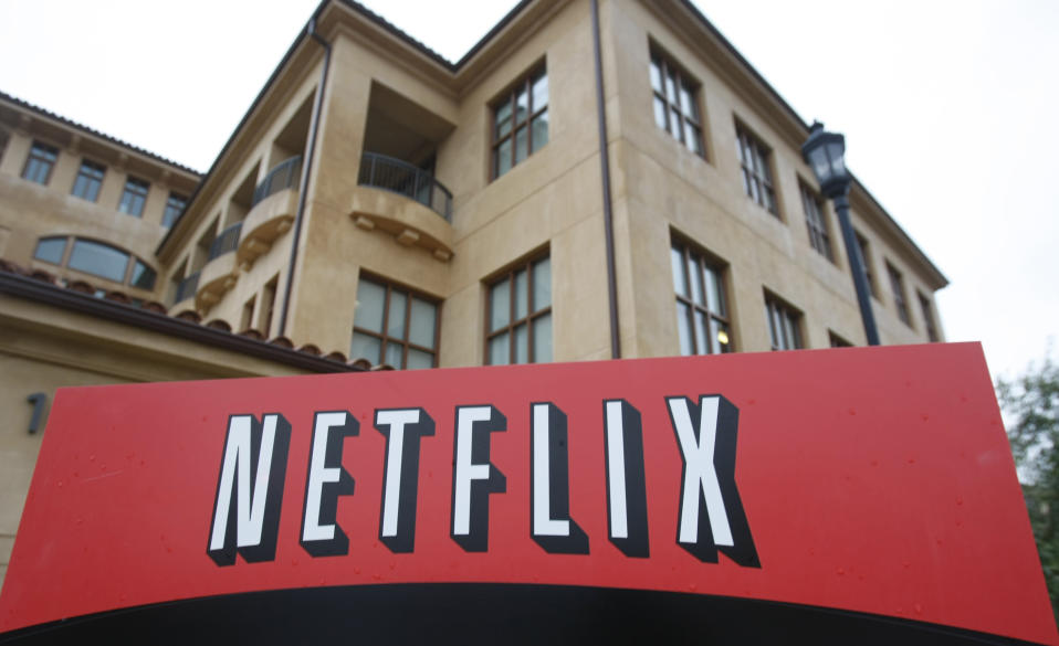 FILE - This Jan. 29, 2010, file photo shows the company logo and view of Netflix headquarters in Los Gatos, Calif. Netflix picked up nearly 16 million global subscribers during the first three months of the year, helping cement its status as one of the world's most essential services in times of isolation or crisis. (AP Photo/Marcio Jose Sanchez, File)
