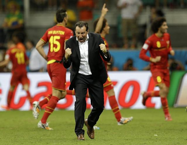 Belgium's head coach Marc Wilmots celebrates after Kevin De Bruyne scored his side's first goal in extra time during the World Cup round of 16 soccer match between Belgium and the USA at the Arena Fonte Nova in Salvador, Brazil, Tuesday, July 1, 2014. (AP Photo/Natacha Pisarenko)