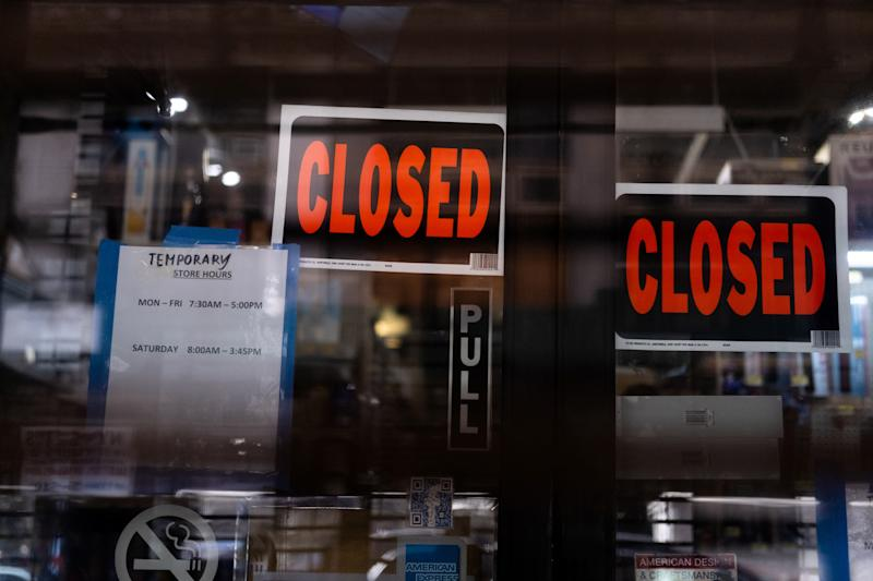 Temporary closed signage is seen at a store in Manhattan borough following the outbreak of coronavirus disease (COVID-19), in New York City, U.S., March 15, 2020. REUTERS/Jeenah Moon - RC2JKF90MMG7