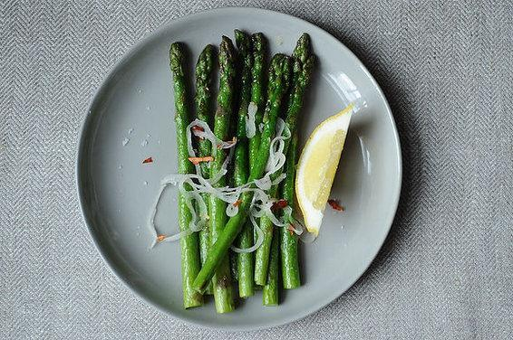 """<div class=""""caption-credit""""> Photo by: Sarah Shatz</div><div class=""""caption-title"""">Asparagus with Shallots, Chiles, and Lemon</div>Sometimes when I learn something new in the kitchen I feel embarrassed that I hadn't figured it out sooner. Cooking asparagus was that way. - Amanda <br> <br> Serves 3-4 <br> 1 small shallot, thinly sliced <br> Coarse salt <br> 2 tbsp. olive oil <br> 1 lb. asparagus, ends trimmed <br> 1 dried red chile, crushed <br> 4 lemon wedges <br> Flaky sea salt <br> <br> 1. Combine shallot with a pinch of salt. Let sit while you cook the asparagus. <br> 2. Heat a large saute pan over medium high heat. Add oil and then asparagus spears, season with salt, and saute. They will brighten in color. Saute until just cooked through, but still crisp-tender at the center, 3-5 min. <br> 3. Arrange asparagus on a platter. Mix together shallot and crushed chile and strew across the asparagus. Serve with lemon wedges. <br> <br> <a rel=""""nofollow noopener"""" href=""""http://www.food52.com/recipes/11282_asparagus_with_shallots_chiles_and_lemon"""" target=""""_blank"""" data-ylk=""""slk:Save and print this recipe on FOOD52."""" class=""""link rapid-noclick-resp"""">Save and print this recipe on FOOD52.</a> <br>"""