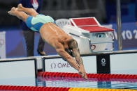Caeleb Dressel, of United States, swims in a men's 100-meter butterfly semifinal at the 2020 Summer Olympics, Friday, July 30, 2021, in Tokyo, Japan. (AP Photo/Jae C. Hong)
