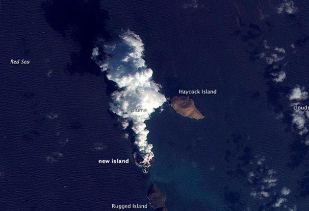 A plume rises from a new island in the Red Sea on Dec. 23, 2011 in this satellite view. The smoke plume and new island were created in a volcanic eruption in December 2011. CREDIT: NASA Earth Observatory