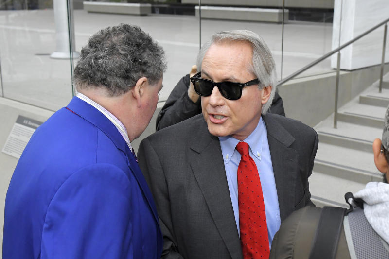 L. Lin Wood, attorney for plaintiff, British cave expert Vernon Unsworth, speaks to reporters before the trial against Tesla CEO Elon Musk at U.S. District Court Tuesday, Dec. 3, 2019, in Los Angeles. Musk is going on trial for his troublesome tweets in a case pitting the billionaire against a British diver he allegedly dubbed a pedophile. (AP Photo/Mark J. Terrill)