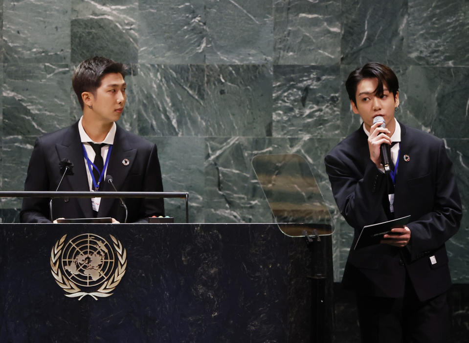 ADDS IDS - Members of South Korean K-pop band BTS, RM, left, and Jung Kook appear at the Sustainable Development Goals meeting during the 76th session of the United Nations General Assembly, at the United Nations Headquarters on Monday, Sept. 20, 2021. (John Angelillo/Pool via AP)