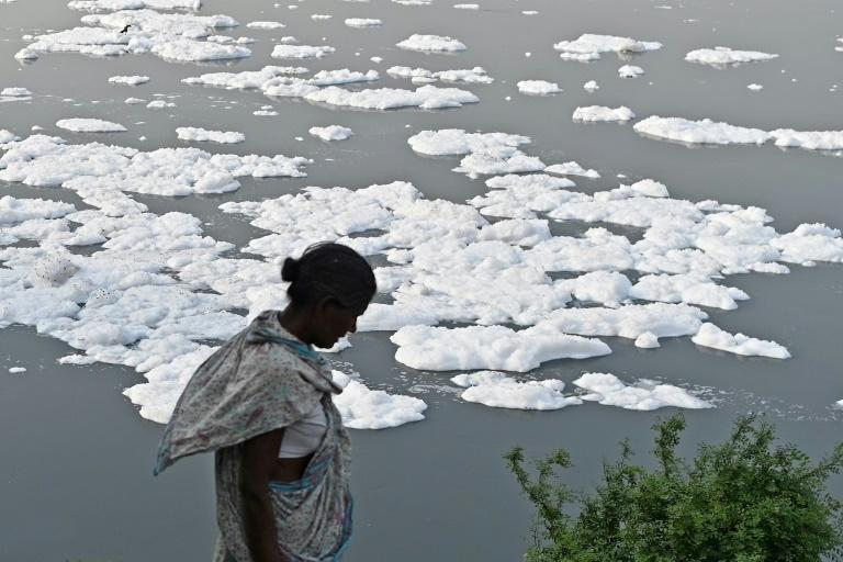 The river Yamuna in India is half covered with foam due to pollution