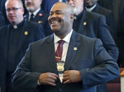FILE - In this Aug. 6, 2018, file photo, William Gross smiles after being sworn in as Boston's first Black police commissioner during ceremonies in Boston. Gross retired on Jan. 29, 2021. (AP Photo/Elise Amendola, File)