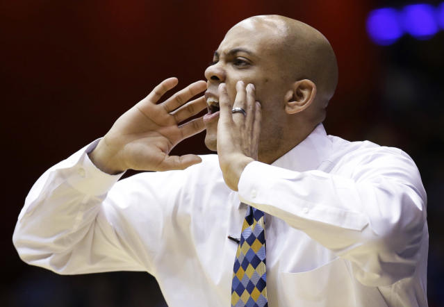 Mount St. Mary's coach Jamion Christian yells to his players in the second half of a first-round game against Albany in the NCAA college basketball tournament, Tuesday, March 18, 2014, in Dayton, Ohio. (AP Photo/Al Behrman)
