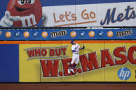 New York Mets left fielder Jeff McNeil (6) leaps but cannot get to a solo home run by Washington Nationals' Asdrubal Cabrera during the second inning of a baseball game Monday, Aug. 10, 2020, in New York. (AP Photo/Kathy Willens)