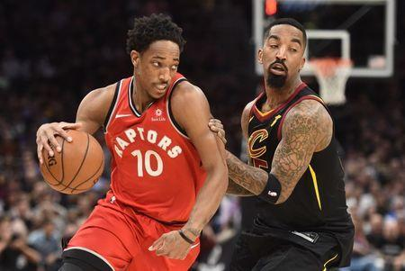 May 5, 2018; Cleveland, OH, USA; Toronto Raptors guard DeMar DeRozan (10) drives to the basket against Cleveland Cavaliers guard JR Smith (5) during the first half in game three of the second round of the 2018 NBA Playoffs at Quicken Loans Arena. Mandatory Credit: Ken Blaze-USA TODAY Sports
