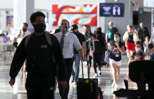 PHOTO: Passengers walk through the United Airlines terminal at George Bush Intercontinental Airport on May 11, 2020 in Houston. (Justin Sullivan/Getty Images, FILE)