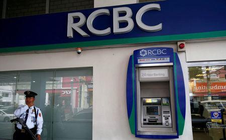 A security guard stands guard outside a branch of Rizal Commercial Banking Corporation (RCBC) in Paranaque city, Metro Manila