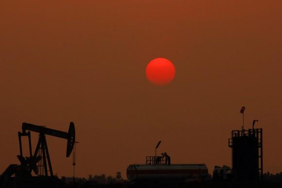 An oil pump with a red moon in the background.