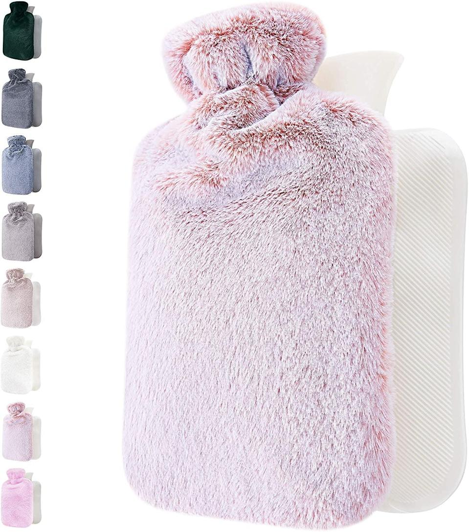 <p>Couch bound with cramps? Cuddle up with this soft and fuzzy faux fur <span>Hot Water Bottle</span> ($14) from Amazon. </p>