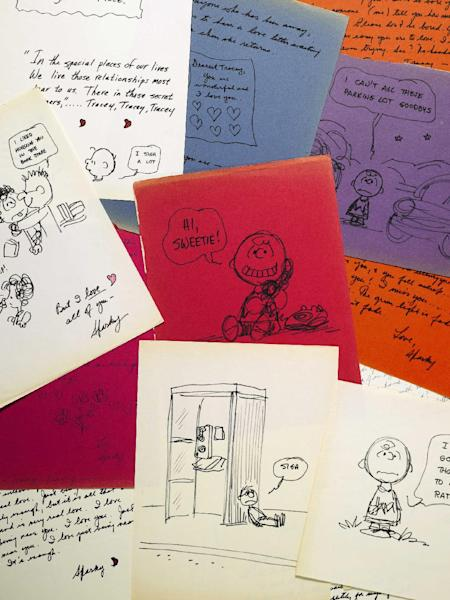 CORRECTS SPELLING OF SCHULZ, NOT SCHULTZ - This photo provided by Sotheby's in New York shows some of the romantic letters and drawings the late Peanuts creator Charles Schulz sent to a young woman 23 years his junior, who infatuated him. Now those love notes from 1970-1971 are being offered for sale at Sotheby's in New York by the family of Tracey Claudius, who the auction house says is ill at her home near Philadelphia. It's estimated they'll bring $250,000 to $350,000 at the Dec. 14 auction. (AP Photo/Sotheby's)