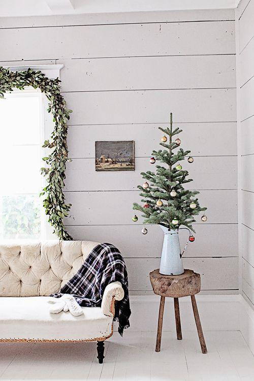 "<p>A mini tree in a pitcher = the farmhouse Christmas of our dreams. Keep a minimalist aesthetic and it'll feel even lighter and airier.</p><p>See more at <a href=""https://dreamywhites.blogspot.com/2015/12/french-farmhouse-christmas-collection.html?utm_source=feedburner&utm_medium=email&utm_campaign=Feed:+DreamyWhites+(Dreamy+Whites)"" rel=""nofollow noopener"" target=""_blank"" data-ylk=""slk:Dreamy Whites"" class=""link rapid-noclick-resp"">Dreamy Whites</a>.</p>"