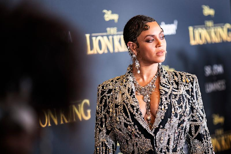 Mandatory Credit: Photo by ETIENNE LAURENT/EPA-EFE/Shutterstock (10331334k) Beyonce poses for photographers on the red carpet prior to the world premiere of 'The Lion King' at the Dolby Theater in Hollywood, California, USA, 09 July 2019. The film will be released in US theaters on 19 July. The Lion King World Premiere - Arrivals, Hollywood, USA - 09 Jul 2019