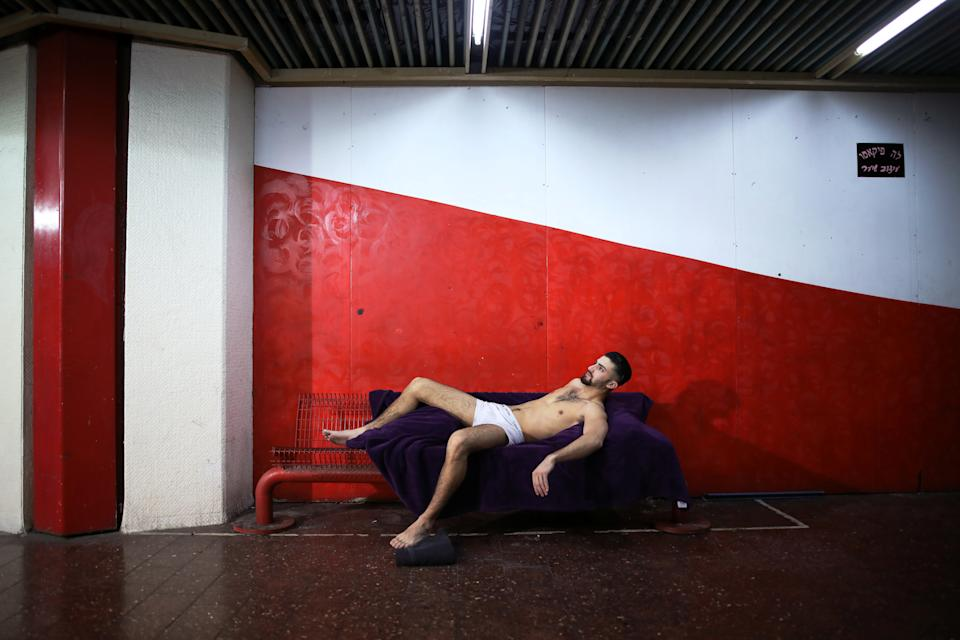 A model poses for an artist at the Central Bus Station on Jan. 11. (Photo: Corinna Kern/Reuters)