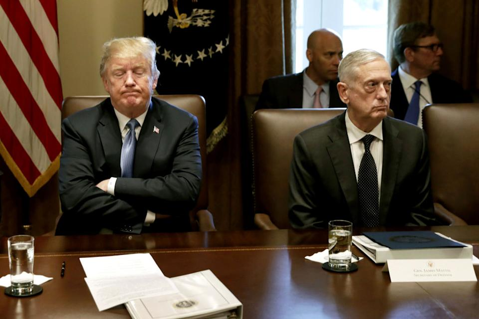 Trump, left, pauses while speaking as James Mattis, US secretary of defense, listens during a Cabinet meeting at the White House in Washington. Source: Getty