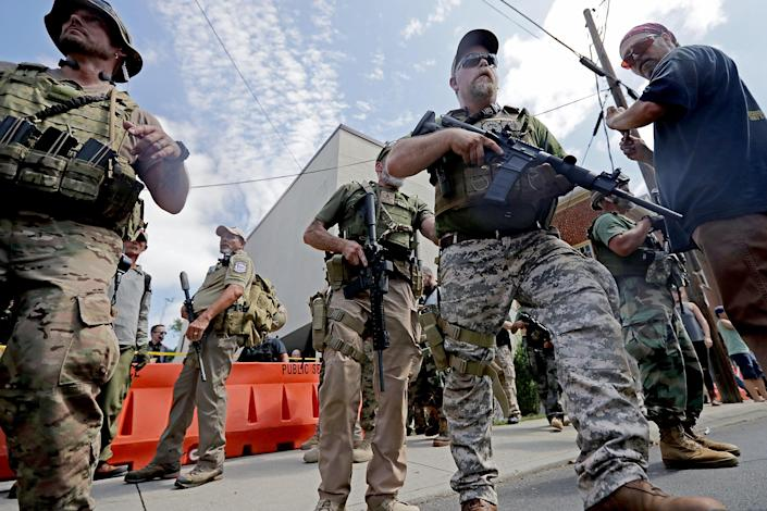 """<p>White nationalists, neo-Nazis and members of the """"alt-right"""" with body armor and combat weapons evacuate comrades who were pepper sprayed after the """"Unite the Right"""" rally was delcared a unlawful gathering by Virginia State Police Aug. 12, 2017 in Charlottesville, Va. (Photo: Chip Somodevilla/Getty Images) </p>"""