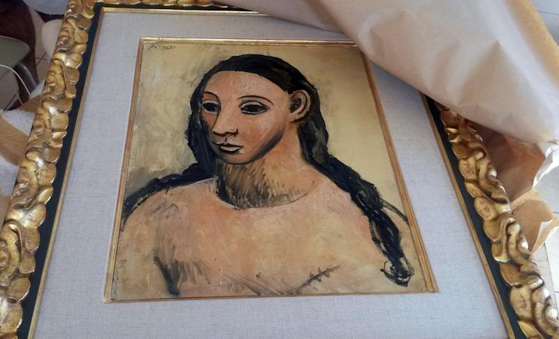 PARIS, FRANCE - JULY 31: A handout picture taken on July 31, 2015 and released on August 3, 2015 by the French Customs office, shows the seized painting 'Head of a young woman' by famous Spanish painter Picasso, at the Customs offices in Calvi. A Picasso worth 25 million euros (£17.5m/US$27.4 million) and considered a cultural treasure by Spanish authorities who had barred it from being exported has been seized from a boat docked at Corsica, according to French authorities on August 4. (Photo by French Customs Office/Anadolu Agency/Getty Images)