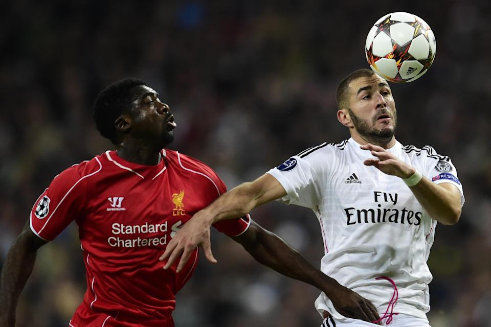 Real Madrid's Karim Benzema (R) and Liverpool's Kolo Toure during their Champions League match in Madrid on November 4, 2014 (AFP Photo/Javier Soriano)