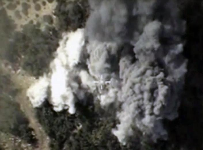 An image purportedly showing explosions after air strikes carried out by Russia's air force in the Syrian province of Latakia (AFP Photo/)