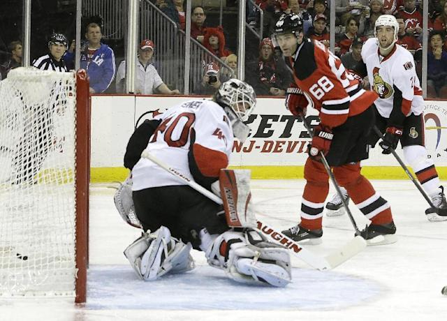 New Jersey Devils right wing Jaromir Jagr (68), of the Czech Republic, scores a goal on Ottawa Senators goalie Robin Lehner, of Sweden, during the second period of an NHL hockey game, Wednesday, Dec. 18, 2013, in Newark, N.J. (AP Photo/Julio Cortez)